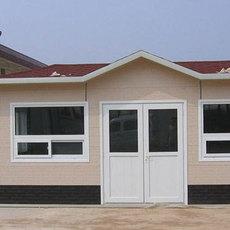 内蒙古乌海岩棉复合板低价供应异型祈虹彩钢板房