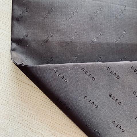 廠家供應 優質滌綸布料 提花布 服裝里布羽絨服西裝布料